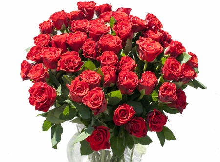 vase with red roses with sunlight on the flowers