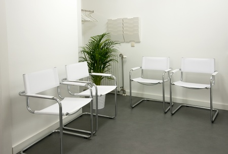 empty waiting room with white chairs