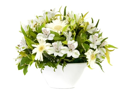 white vase and flowers on light background photo