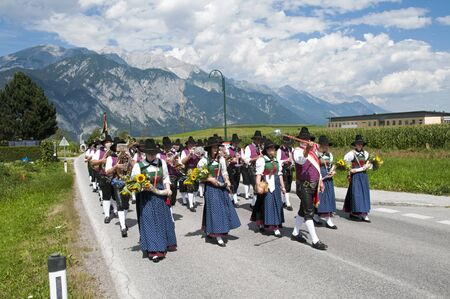 AXAMS,AUSTRIA - AUGUST 15 Unidentified people walking in procession to the church on Maria Ascension,on August 15, 2012 in Axams, Austria  Maria Ascension is the anual christian celebration in Axam Stock Photo - 14963175