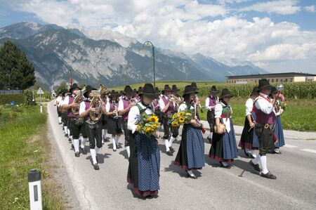 AXAMS,AUSTRIA - AUGUST 15 Unidentified people walking in procession to the church on Maria Ascension,on August 15, 2012 in Axams, Austria  Maria Ascension is the anual christian celebration in Axam Stock Photo - 14963173