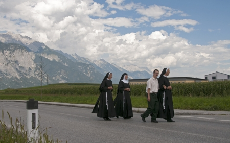 AXAMS,AUSTRIA - AUGUST 15 Unidentified people walking in procession to the church on Maria Ascension,on August 15, 2012 in Axams, Austria  Maria Ascension is the anual christian celebration in Axam Stock Photo - 14963166