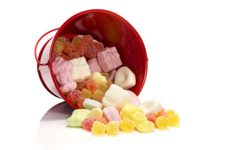 red bucket with candy for the childrens party sinterklaas in december in Holland Stock Photo - 15737025