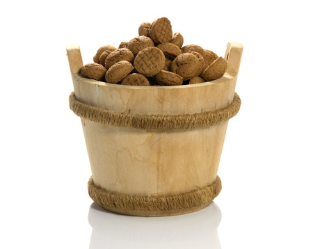 pepernoten: wooden sauna bucket with dutch pepernoten candy for children with sinterklaas party on 5 december