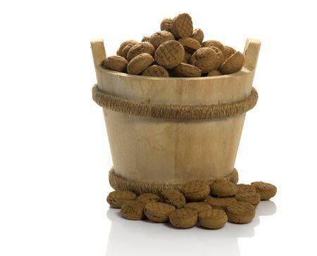 biscuts: wooden sauna bucket with dutch pepernoten candy for children with sinterklaas party on 5 december