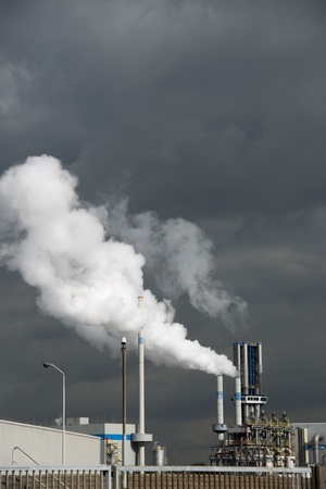 Heavy smoke from industrial chimney polluting the environment photo