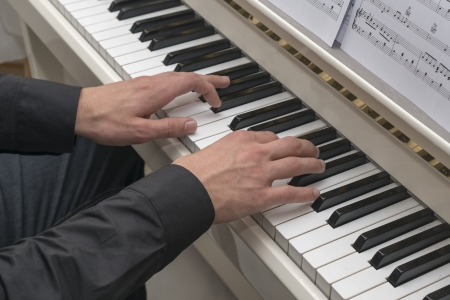 male hands on black and white piano Stock Photo - 16122406