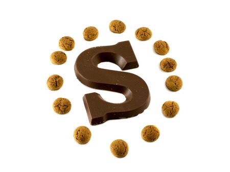 the letter S from chocolate and dutch pepernoten Stock Photo - 16122419