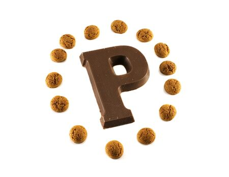 the letter P from chocolate and dutch pepernoten Stock Photo - 16122418