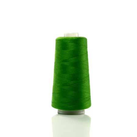 bobbin:  bobbin with green thread isolated on white