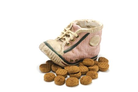 pepernoten: shoe made from stone with pepernoten for the dutch sinterklaas party