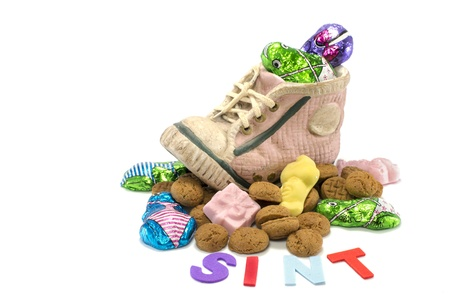 childrens shoe with pepernoten and other candy for the dutch sinterklaas party Stock Photo - 16418192