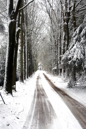 icey: road and house in the snow in Dutch winter