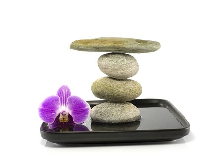 stones and orchid in balance on water photo