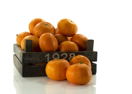 old wooden box with tangarine fruit photo