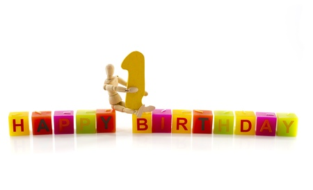 happy birthday candle letters with puppet and the number one Stock Photo - 17684251