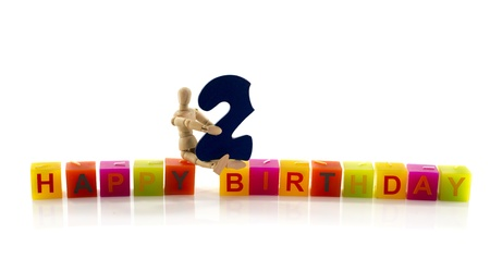 happy birthday candle letters with puppet and the number two Stock Photo - 17684253