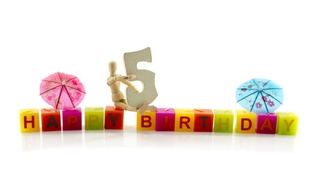 happy birthday candle letters with puppet and the number five Stock Photo - 17684255