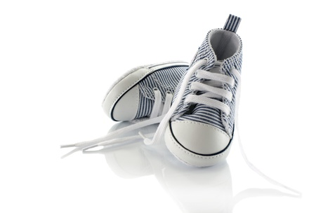 small baby sport shoes on white background