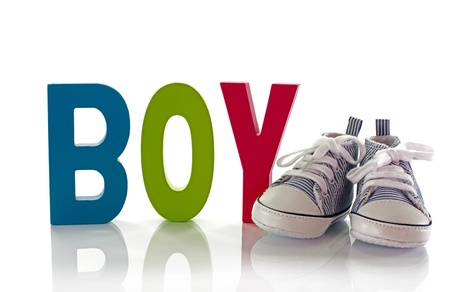 small baby shoes with wooden boy text Stock Photo - 17802876