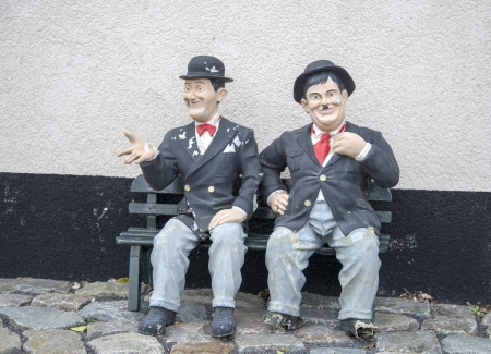 hardy: funny Laurel and hardy on a bench in garden