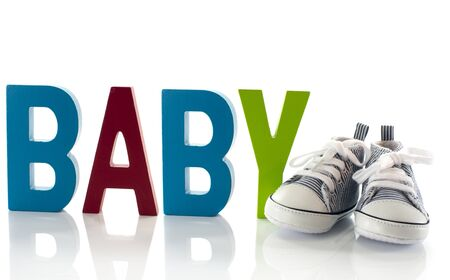 baby sport shoes with wooden text Foto de archivo