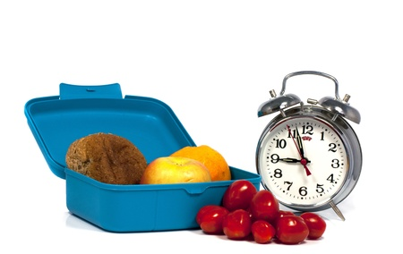 time for lunchbox at school with the clock at nine photo