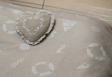 heart shape pillow on the bed blanket Stock Photo - 18030442