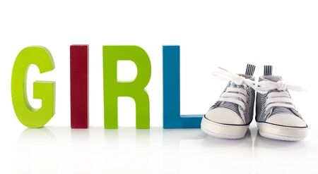 baby shoes with the letters girl Stock Photo - 18278779