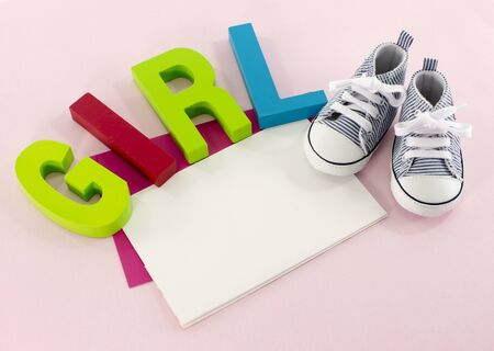 baby shoes with the letters girl photo