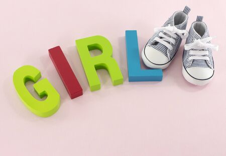 0 6 months: baby shoes with the letters girl