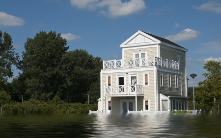house flood: big wooden house with blue sky and white clouds in high water