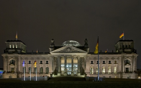 The Reichstag building at night in Berlin, Germany photo