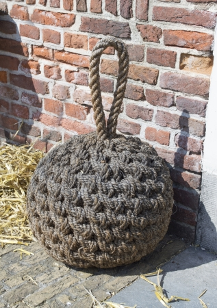 traditional door stop made from ropes Stock Photo