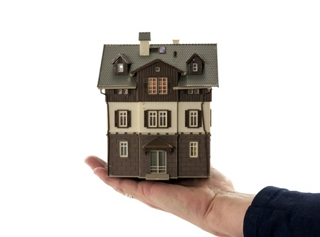 hand holding house with  white background photo