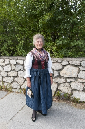 traditonal: AXAMS,AUSTRIA - AUGUST 15 Unidentified woman showing traditonal dress,on August 15, 2012 in Axams, Austria This dress is worn only at  Maria Ascension is the annual christian celebration in Axam