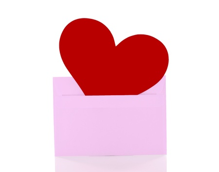 red heart in a pink enveloppe isolated on white photo