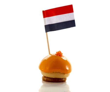 flad: dutch orange pastry with flag in red white blue Stock Photo
