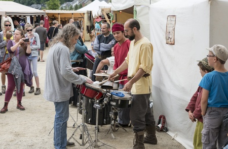 сooking: people playing music on the market in the belgium city bouillon
