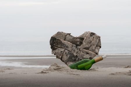 love message in green bottel photo