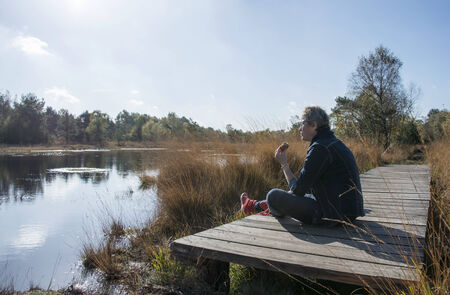 venn: woman relax and using lunch at the gilderhauser venn nature area Stock Photo