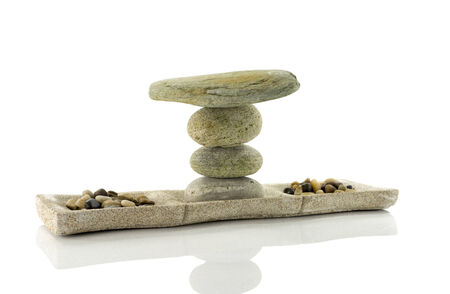 tower stack of stones in perfect balance isolated on white photo