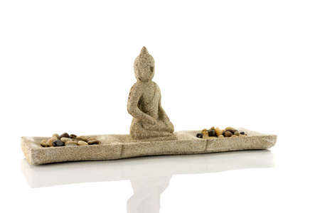 stones and budha statue isolated on white photo