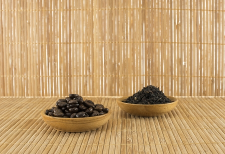dryed: coffee beans and  tea leaves on bamboo table