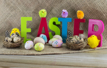 easter with letters on wooden table photo