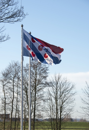 friesland: the friesland and dutch flag together in the wind Stock Photo