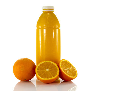 bottle with fresh orange juice isolate on white photo