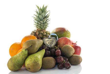 fruit as oranges pineapple grapes and kiwi isolated on white with thinking of you plate photo