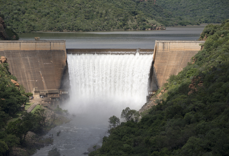 the swadini dam with waterfall in the blyde river south africa  photo