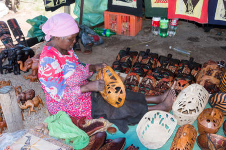 TZANEEN; SOUTH AFRICA- MAR 15; 2014: Unidentified african  woman selling hand made art on the market for tourists on the panarama route.This route is most popular route in south africa